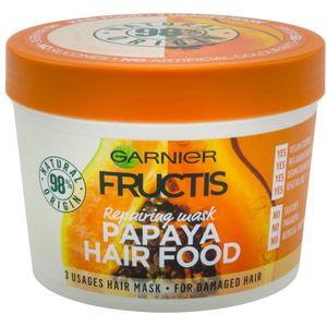 Garnier Fructis Hair Food Papaya maska za oštećenu kosu 390 ml  Smanjuje ispucane vrhove i oštećenu kosu sve do vrhova tijekom dužeg razdoblja.  Može se upotrebljavati kao:  1. Regenerator: nanesite na vlažnu kosu, a zatim isperite za lako raščešljavanje i...