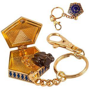 Privjesak za ključeve u obliku kutijice s čokoladnom žabom. Veličina: 4cm.