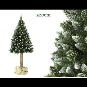 Umjetno božićno drvce s deblom od pravog drveta.